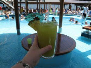 enjoy drink on pool deck